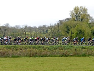PR agency MGMPR - 3 May 2015; A general view of the action as the peloton approach Killylea, Co. Armagh, during the third stage. 150 elite cyclists from Australia, Holland, Belgium, France, England, Scotland, Northern Ireland and the Republic of Ireland compete in Stage 3 of the AmberGreen Energy Tour of Ulster in partnership with the SDS Group and Saltmarine Cars. Stage 3 takes the cyclists from Newry - Camlough - Newtownhamilton - Keady - Markethill - Hamiltonsbawn - Richill - Armagh - Caledon - Aughnacloy - Ballygawley (Whitebridge Road) - Pomeroy - Donaghmore - Cookstown. Picture credit: Stephen McMahon / SPORTSFILE