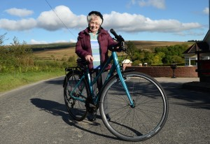 Cycle Sperrins 13th October 2015 Annie Slane, 90 year old resident and Cyclist in the Broughderg Area, at the launch of t he Cycle Sperrins Consortium, which is made up of speciality food producers, farm businesses, tearooms and quality accommodation providers based along the world-class four day cycle route, welcomes Tourism NI chairman, Terence Brannigan, to officially launch Cycle Sperrins. Picture Oliver McVeigh - For further information contact Eleanor McGillie at MGMPR Ltd - PR Northern Ireland .