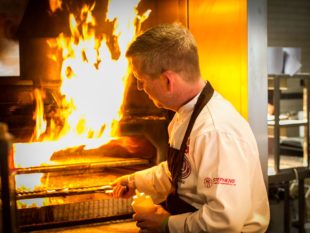 Executive Chef Dean Coppard firing the Josper Grill at Uluru Bar & Grill. MGMPR_IMG_6768