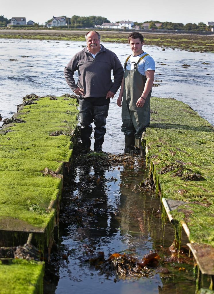 Patrice Bonnargent and his son Luc at their oyster farm in County Down