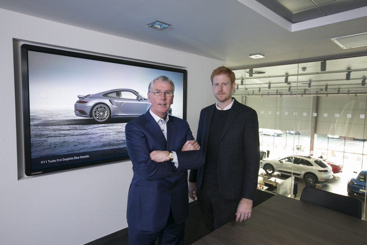 MD of NIAVAC James Conlon and Ross Wylie in Porsche Centre Belfast