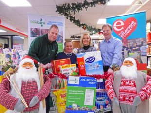 From left, Gavin Emerson, Marissa Quinn and Alessie Magowan from The Emerson's Foundation with Richard Thompson from the Armagh Foodbank launching the Christmas Trolley Appeal P1030943A